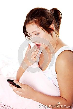 Shocked teen girl reading sms.
