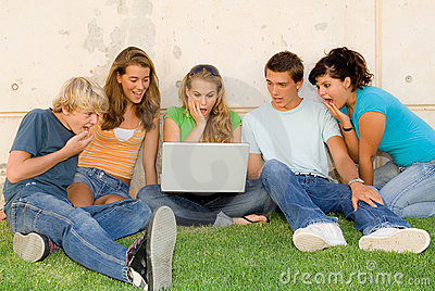 Shocked teens with laptop