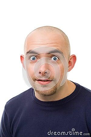 Shocked unshawen young bold man