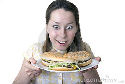 Shocked woman with hamburgers