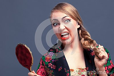Shocked woman in a with mirror