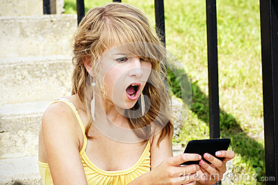 Shocked young blond reading text