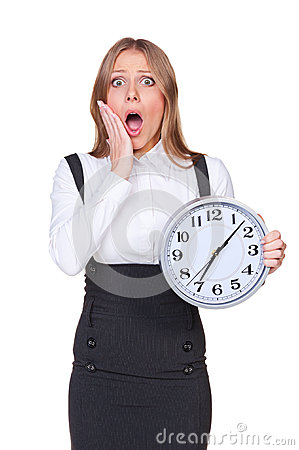 Shocked young woman holding the clock