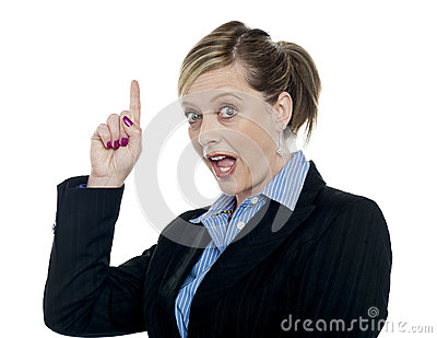 Shocking corporate woman pointing upwards