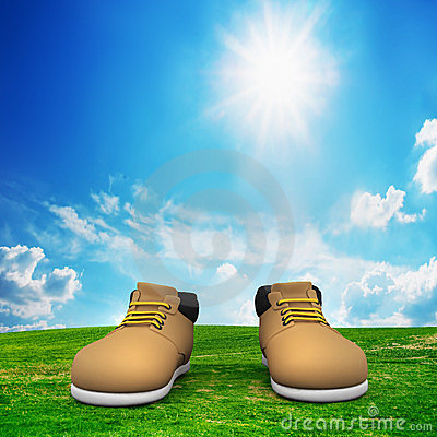 Shoes on green field. Adventure