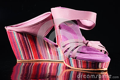 Shoes in rainbow colors on isolated background