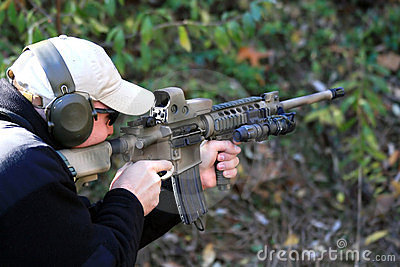 Shooter Pointing AR15