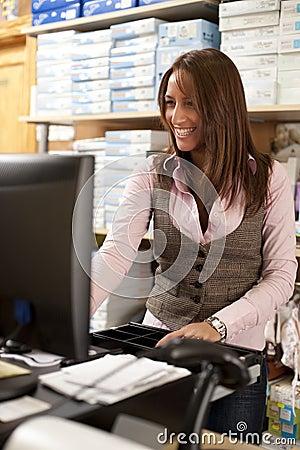 Shop assistant at cash