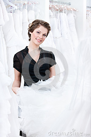 Shop assistant try to select a proper dress