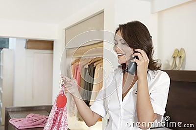 Shop Attendant on Phone
