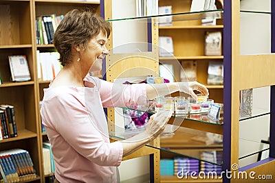 Shop Owner Arranges Display