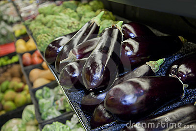 Shop vegetable department with aubergines
