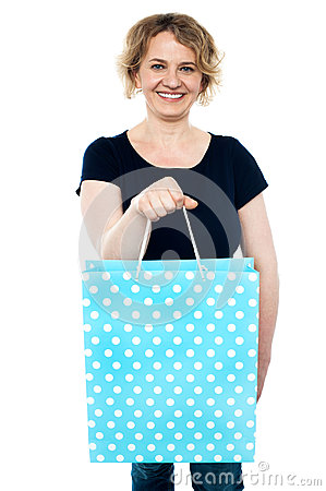 Shopaholic female holding shopping bag