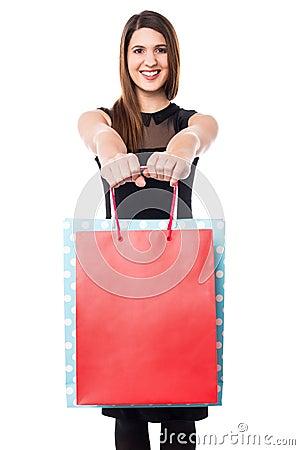 Shopaholic girl holdng shopping bags