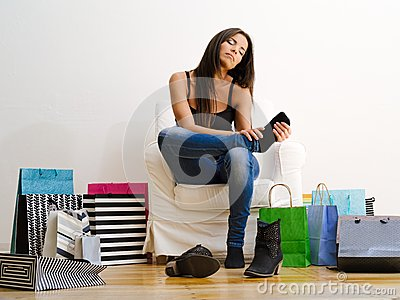 Shopaholic Rubbing Her Tired Feet Royalty Free Stock