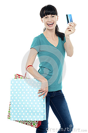 Shopaholic woman holding her cash card up