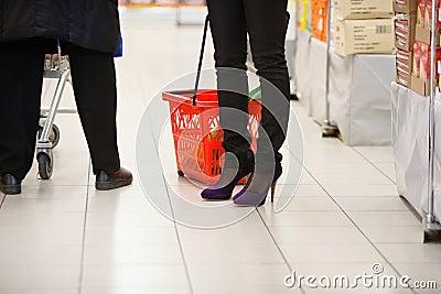Shoppers Legs in Supermarket