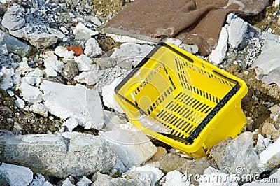 Shopping basket among rubble and rubbish