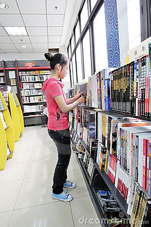 Shopping in a bookshop Editorial Image
