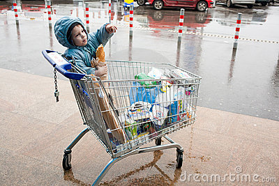 Shopping cart and child Editorial Photography