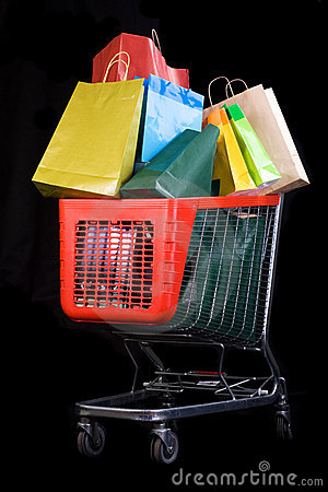 Free Shopping Cart Full Of Gifts On Black Background Royalty Free Stock Photo - 7430665