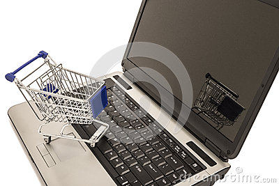 Miniature shopping cart on laptop computer