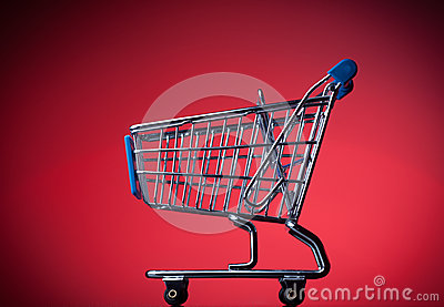 Shopping cart on red background