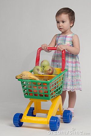 Shopping concept - child with shopping cart