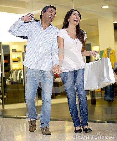 Shopping couple laughing