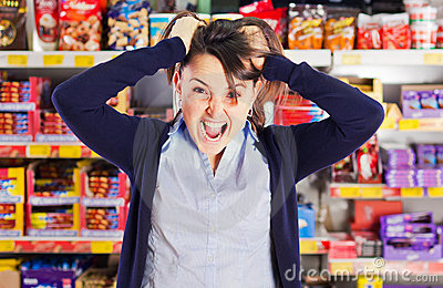 Attractive woman yelling or screaming in grocery s