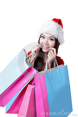 Shopping för härlig jul för påsen tar lycklig kvinnan