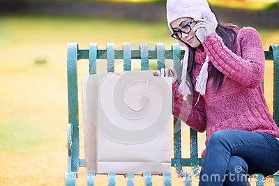Shopping girl on the bench