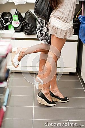 Shopping girls on tiptoe