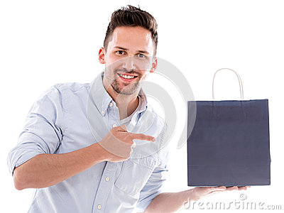 Shopping man pointing at a bag