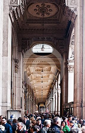 Shopping in Milan: Crowded arcade Editorial Photo