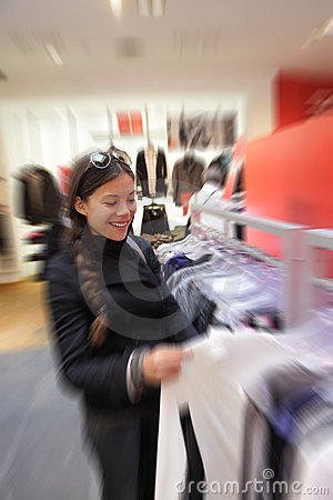 Shopping woman in clothes store