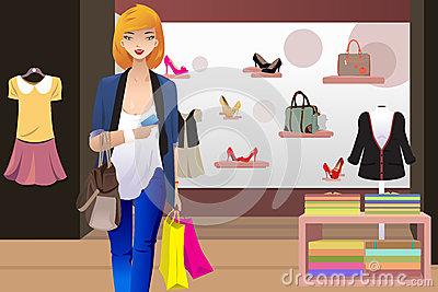 of shopping woman inside the clothing store holding a credit card