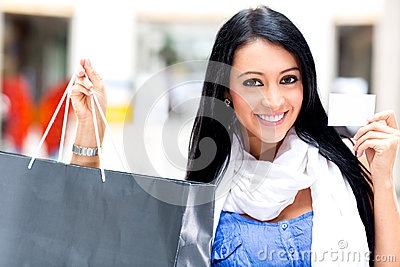 Shopping woman paying by card