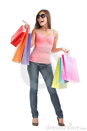 Shopping woman pointing full body isolated