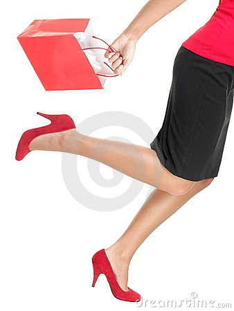 Shopping woman running holding bag