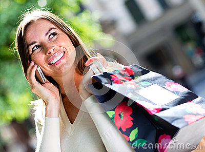 Shopping Woman Talking On Her Cell Royalty Free Stock Photo - Image: 26599095