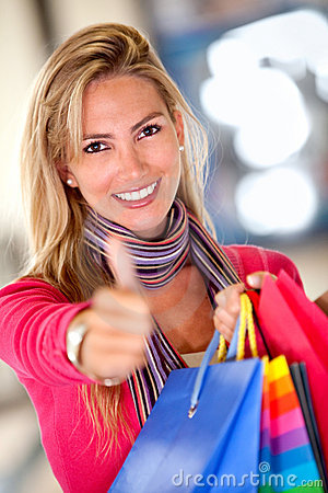 Shopping woman with thumbs up