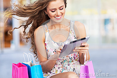 Shopping woman using digital tablet