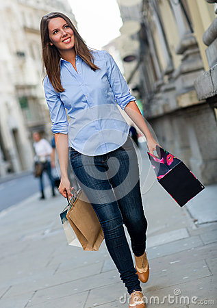 Shopping woman walking with bags