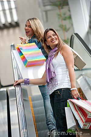 Shopping women on escalators