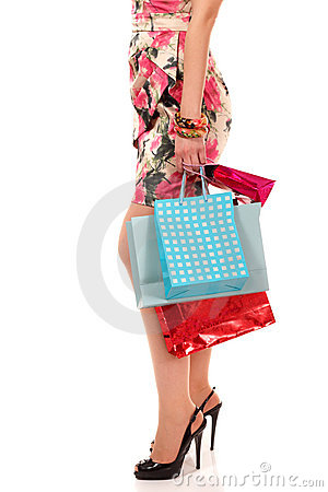 Shopping young woman holding bags
