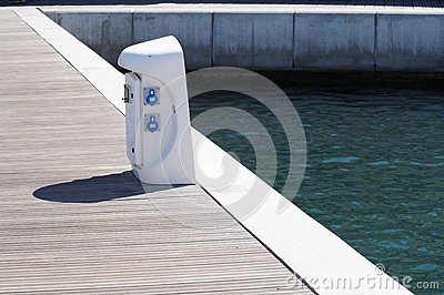 Shore Based Electricity Supply Appliance With Lantern On Top For Boats Power And Battery Charged . Stock Photo