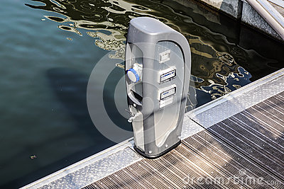 Shore Based Electricity Supply Appliance With Lantern On Top For Boats Power Supply And Battery Charged Stock Photo