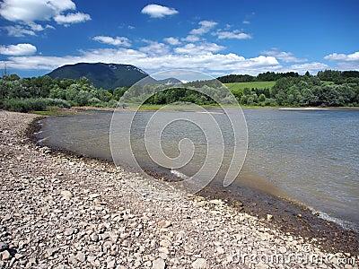 Shore of Liptovska Mara lake and Western Tatras