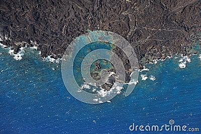 Shoreline with lava rocks.